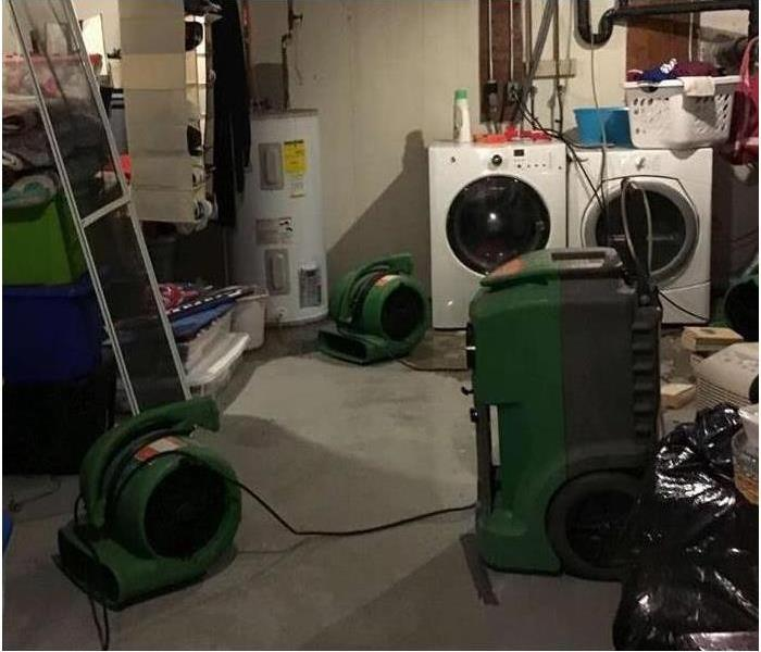 dry unfinished basement with servpro equipment