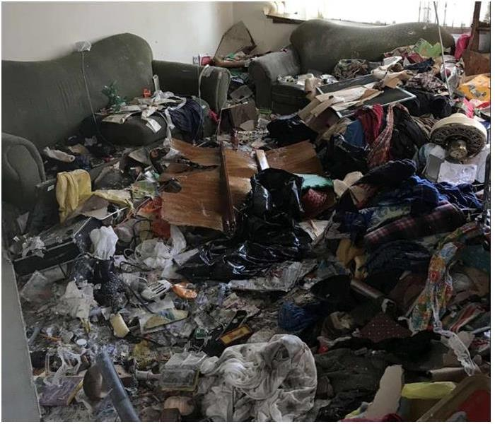 hoarding in a room, debris and items covering everything