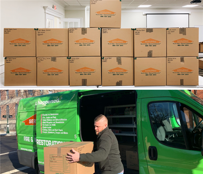 servpro boxes full of donations, and a marketer unloading donations from a servpro van