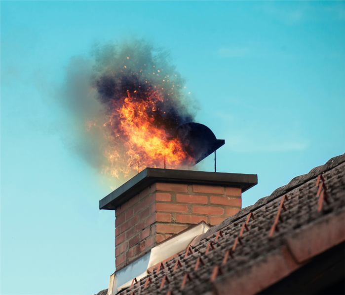 photo of flames coming out of chimney because of a chimney fire